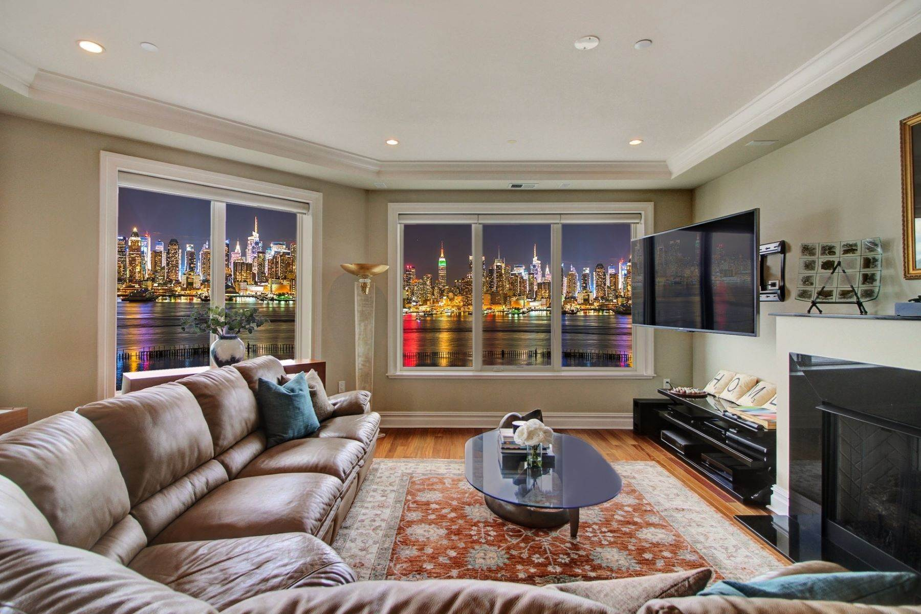Condominiums for Sale at Nothing like this is available! Enjoy unobstructed panoramic views of NYC 250 Henley PL #402 Weehawken, New Jersey 07086 United States