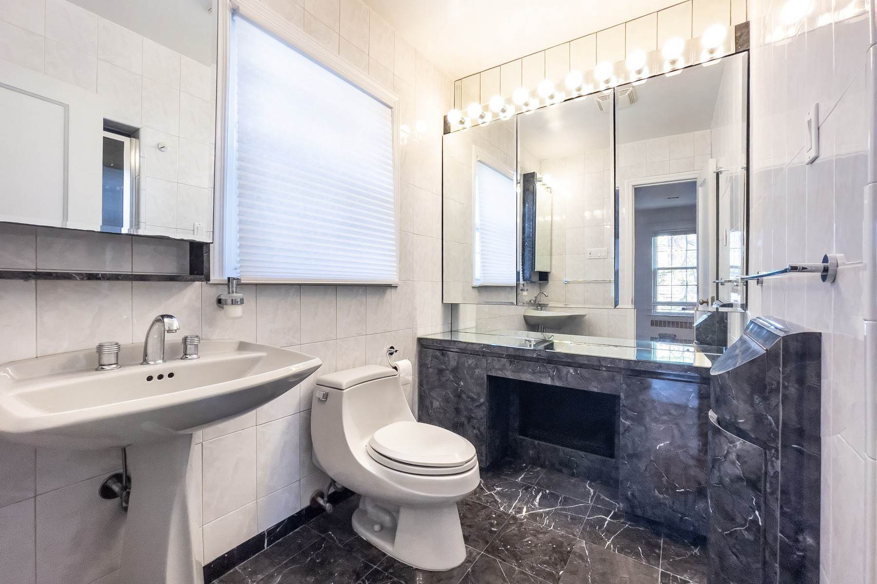 12. Single Family Homes for Sale at 'GRACIOUS LIVING IN KEW GARDENS' 103 Mowbray Drive, Kew Gardens, New York 11415 United States