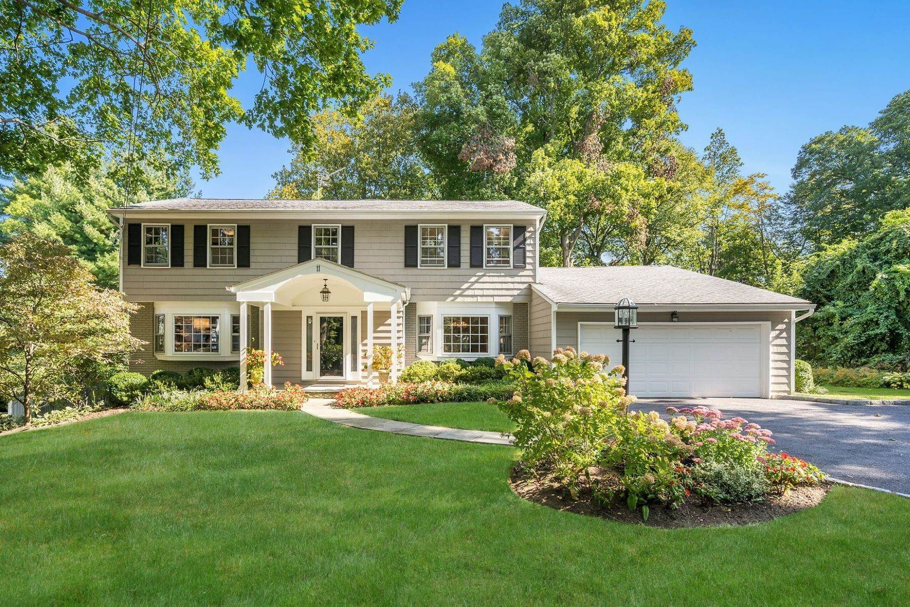 Single Family Homes for Sale at Fabulous Move-In Condition Center Hall Colonial 11 Greenville Road Scarsdale, New York 10583 United States
